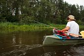 image of canoe boat man  - Man fishing in river from canoe pure nature scene - JPG