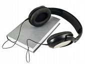 Постер, плакат: Headphones over a book composition