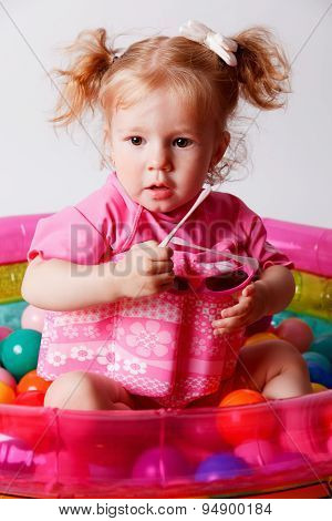 Cute baby In A Protective Float Swimsuit