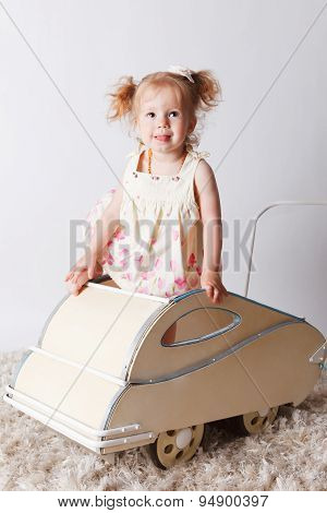Pretty Baby Girl In A Retro Pram