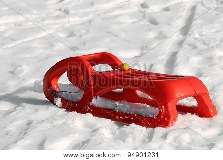 Reb Sled For Playing In The Snow In Mountains