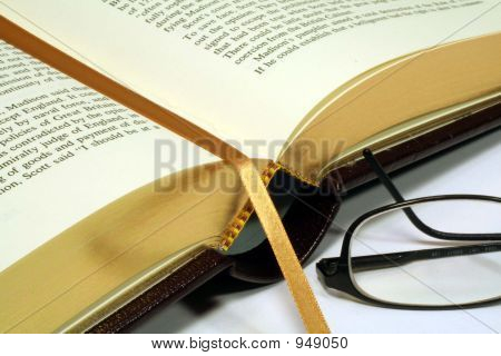 Gold Embossed Book With Reading Glasses