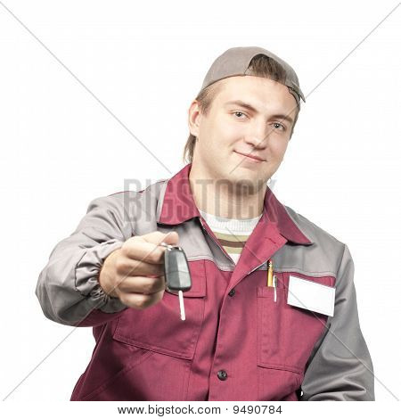 Mechanic Giving A Car Key