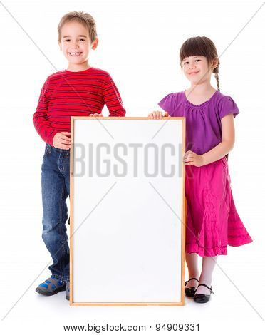Cute Girl And Boy Showing Blank Ad
