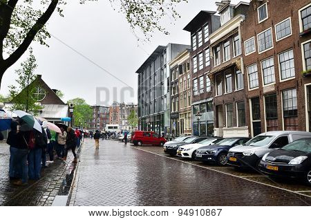 Amsterdam, Netherlands - May 16, 2015: Tourists Queuing At The Anne Frank House