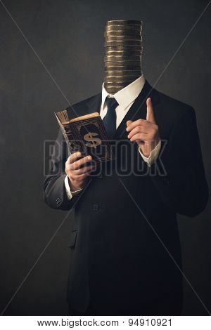 Businessman With Moral Pointing Finger And Handbook For Making Money