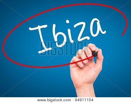 Man Hand writing Ibiza with black marker on visual screen.