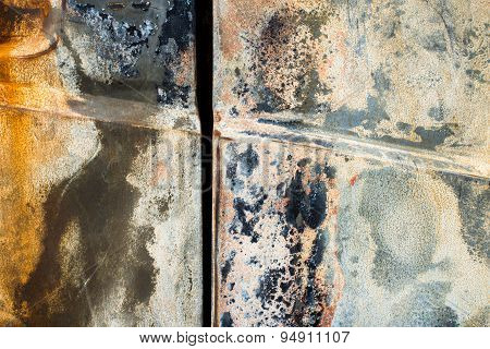 Rusty Surface Of The Burnt Car Doors
