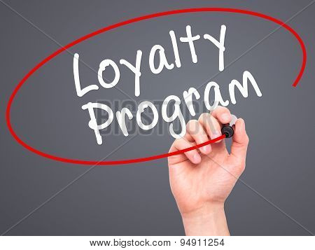 Man Hand writing Loyalty Program with black marker on visual screen