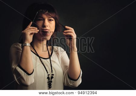 Laughing Woman With Serious Reflection
