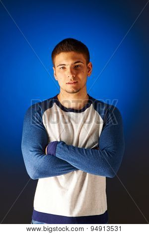Portrait of serious man against blue background