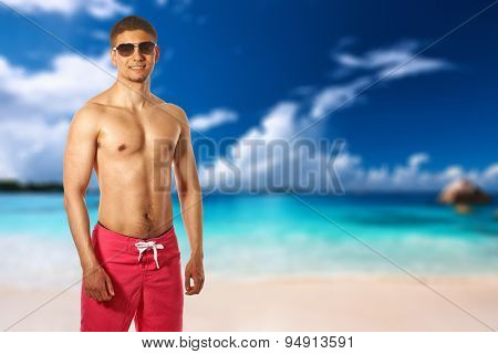 Man on beach at Seychelles, Praslin, Anse Lazio. Collage.