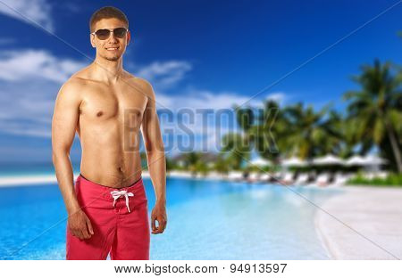 Man at swimming pool in the tropical hotel. Collage.