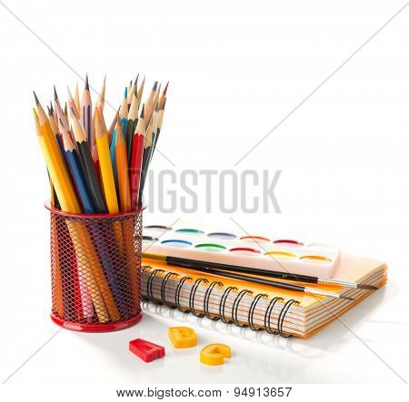 School equipment with pencils, paints and brushes isolated on white.  Back to school concept.