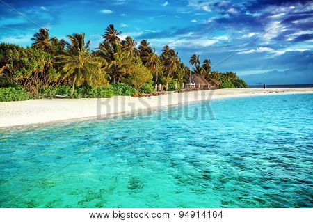 Beautiful paradise beach, luxury tropical resort, turquoise transparent sea around the island with fresh green palm trees on the coast, summer vacation on Maldives, Asia