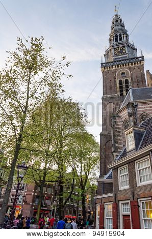 Amsterdam, Netherlands - May 8, 2015: Tourists Around Old Church (oude Kerk), Amsterdam, Netherlands