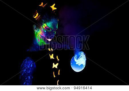 Woman with luminous make up and bubble's smoke