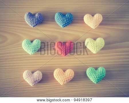 Colorful Yarn Hearts On Wood Background