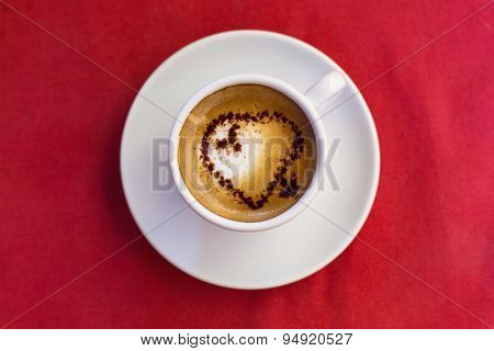 Coffee Cup With Milk And Heart Shape On Red Background