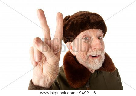 Russian Man In Fur Cap Making Peace Sign