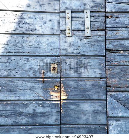 Abstract Cross Santo   Brass Brown   Wood Door   Varese Italy