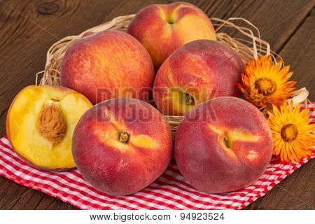 Peaches on red checkered tablecloth