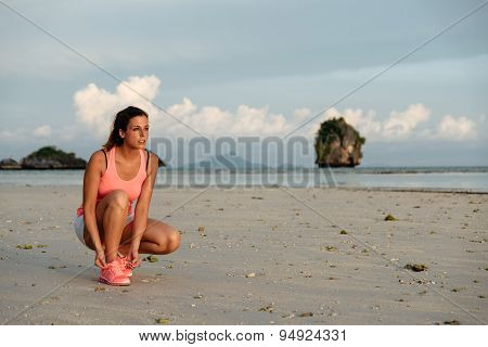 Female Athlete Ready For Running At Beach