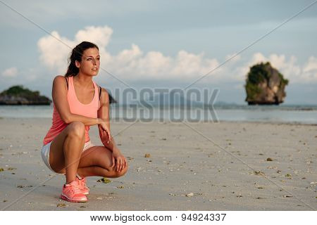 Motivated Sporty Woman Before Running At Beach