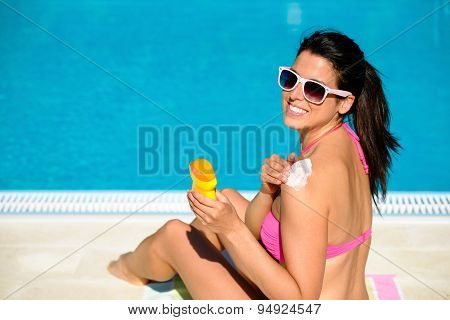 Woman Protecting Her Skin With Sunscreen On Summer
