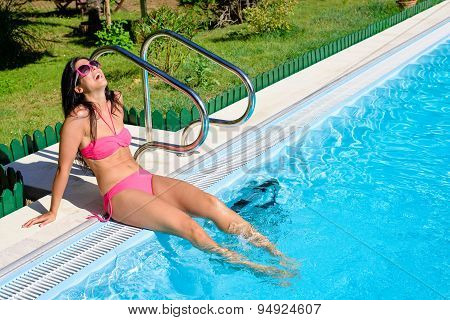 Woman Enjoying Summer Vacation At Poolside