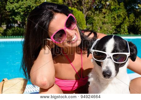 Woman And Dog Having Fun On Summer Vacation