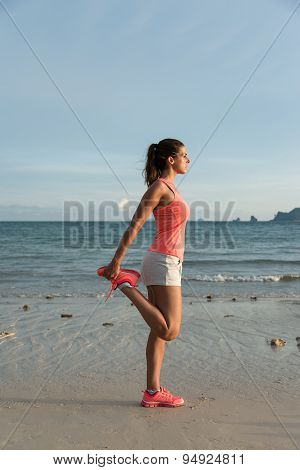 Sporty Woman Stretching Before Running