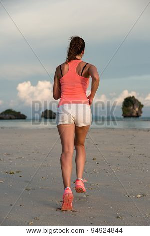 Sporty Fitness Woman Running At The Beach