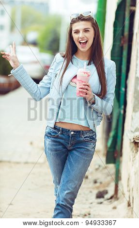 young beautiful happy stylish hipster girl, cocktail, smoozy drink, denim jacket, smiling, fashion,