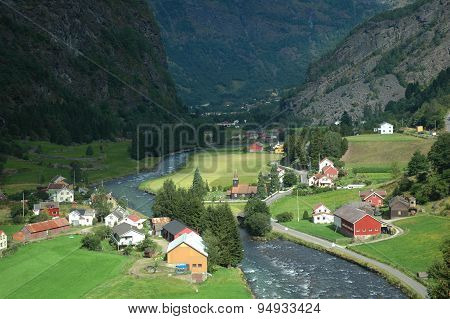 A Small Village In A Green Background Between The Fjords In Norway