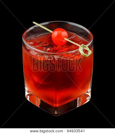 Red drink with a maraschino cherry isolated on black