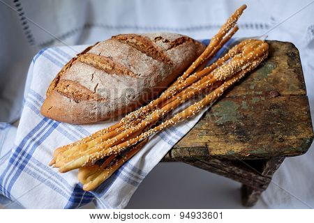 Close-up Of Traditional Bread And Italian Breadsticks.
