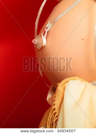 Pregnant Woman With Dummy For Unborn Baby