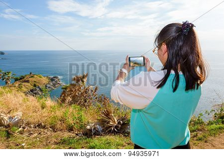 Woman Taking Photograph With Smartphone