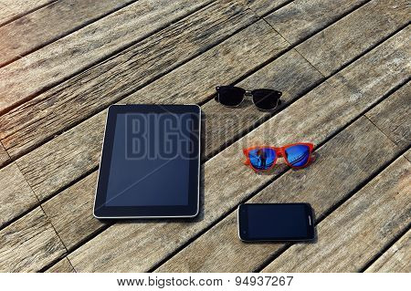 Mock up presentation with blank screen digital tablet smart phone and couple of sunglases