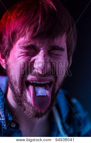 Close-up On Junkie Man Taking Lsd