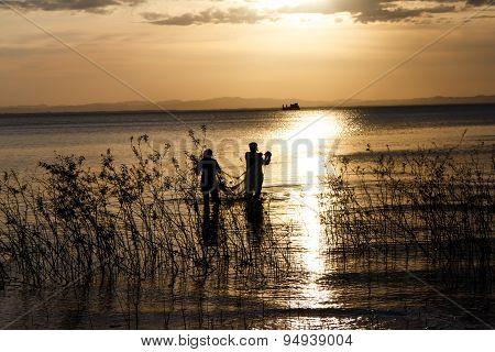 Cross-light Of People In Lake, Ometepe, Nicaragua