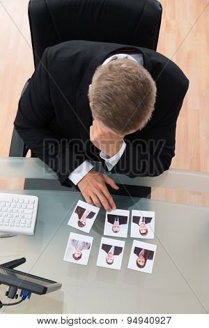 Businessman Looking At Candidates Photograph