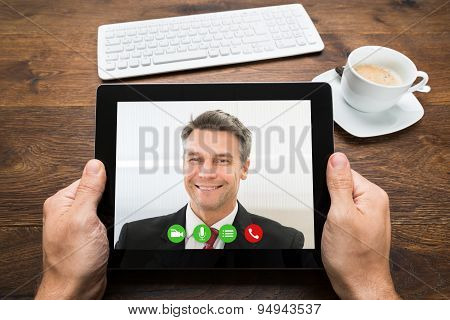 Businessperson Video Chatting With Colleague
