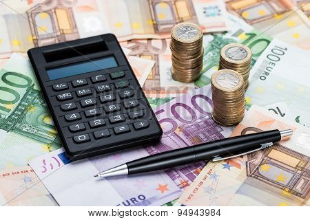Calculator And Pen On Euro Currency
