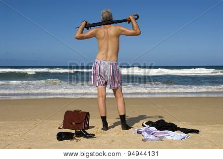 Businessman Undressing On A Tropical Beach
