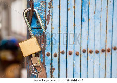 Old Open Padlock And Key With Old Steel Door