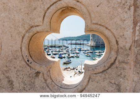 Dubrovnik Harbor Through Feature Opening In Ancient Wall.