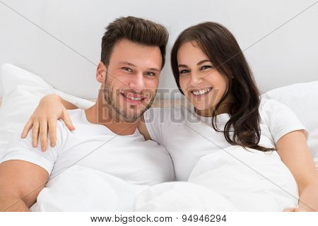 Happy Couple On Bed