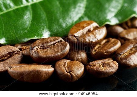 Macro Closeup Shot Of Coffee With Green Leaf On Black